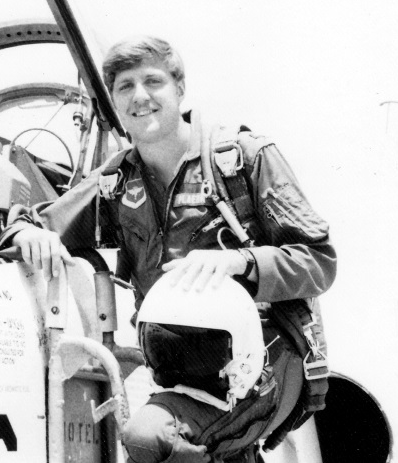 That's me back in my fighter pilot days learning the kind of discipline and focus I now apply to researching high-yield dividend and income investments.
