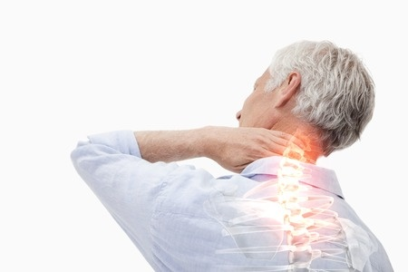 42517168 - digital composite of highlighted spine pain of man