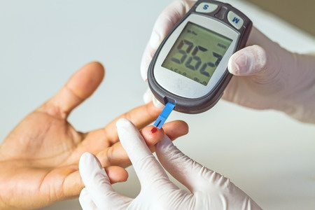 49242073 - blood glucose meter, the blood sugar value is measured on a finger