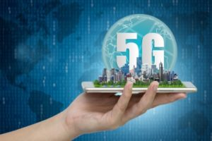 5G network wireless systems and internet of things, Smart city and communication network with Modern city model on smartphone in hand,  Connect global wireless devices.