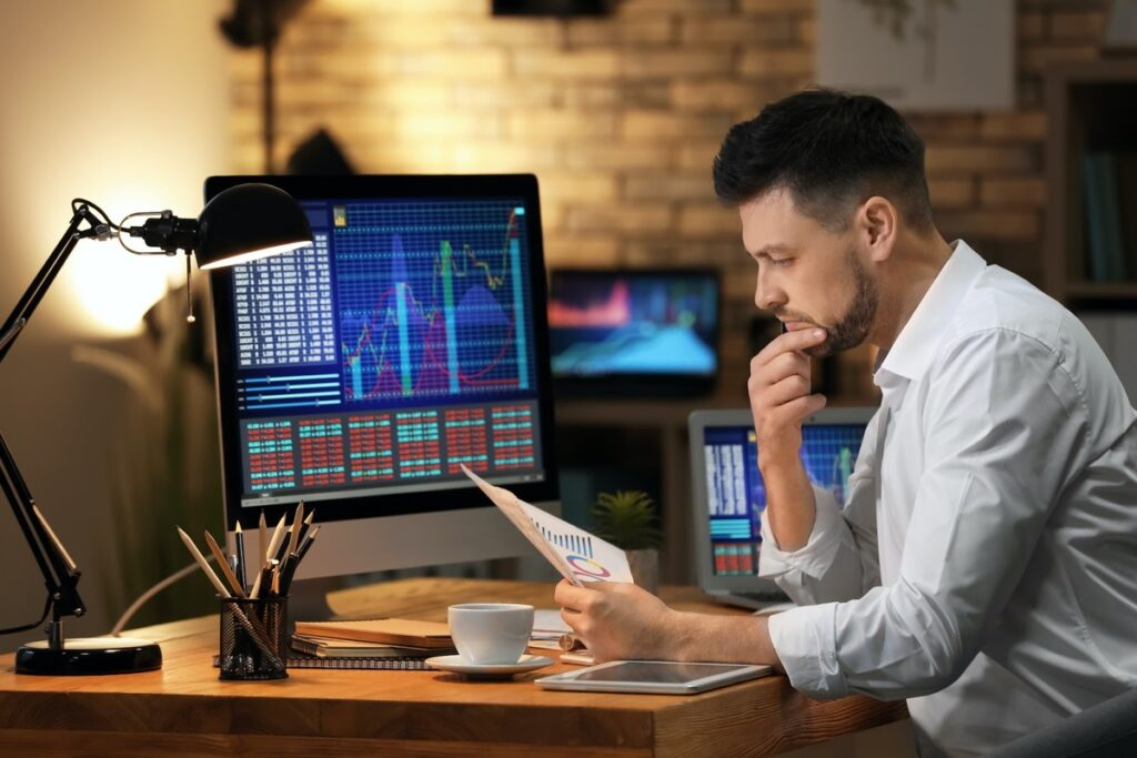 A stock trader looking at a chart