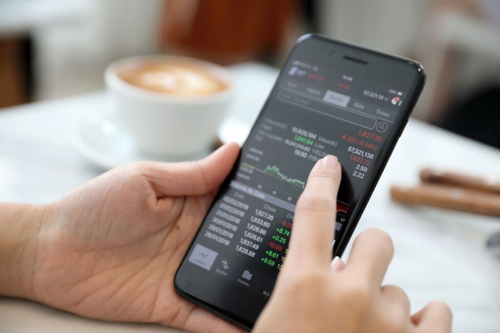 Dividend income: A finger scrolling on a stock market mobile app