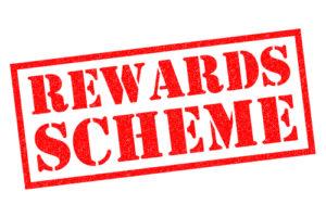 REWARDS SCHEME red Rubber Stamp over a white background.