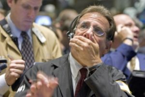 Traders work on the floor of the New York Stock Exchange Tuesday July 29, 2008. Stocks rose Tuesday, rebounding a day after their steep tumble as a jump in consumer confidence offset some of the market's increasing concerns about the financial sector.  (AP Photo/Richard Drew)
