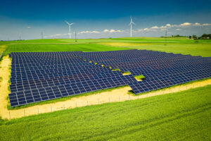 Amazing view of solar panels and wind turbines in summer