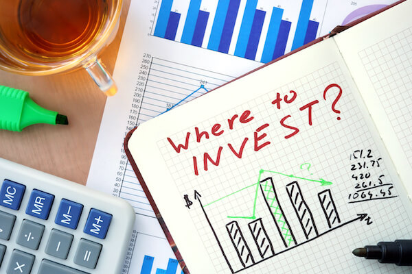 Different types of stocks: Where to INVEST? written in a notebook