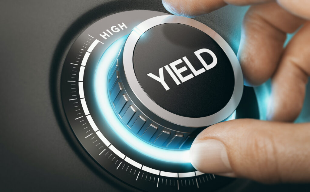 Best dividend stocks: A hand turning a knob to select high yield
