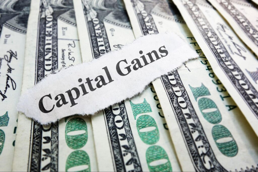 capital gains yield: dollars with a piece of paper saying capital gains