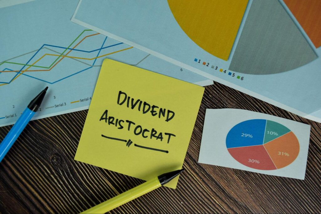 dividend stocks for retirement: dividend aristocrat written on a yellow sticky note
