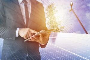 Businessmen calculate investment, breakeven, losses, finances, renewable energy, men wear a black suit, work with a computer. Internet, modern, solar cell.
