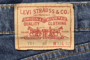 Chisinau, Moldova - August 19, 2016: Closeup of Levi's leather jeans label sewed on a blue jeans isolated on white background.Levi Strauss & Co is a privately held American clothing company.
