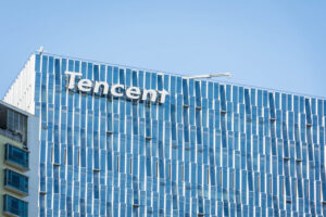 SHENZHEN, CHINA, JANUARY 9 2018: Logo of Tencent on the skyscraper of headquarters. Tencent is one of the largest Internet, gaming and technology companies in the world
