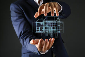 48824858 - real estate offer. businessman holds an artificial model of the house