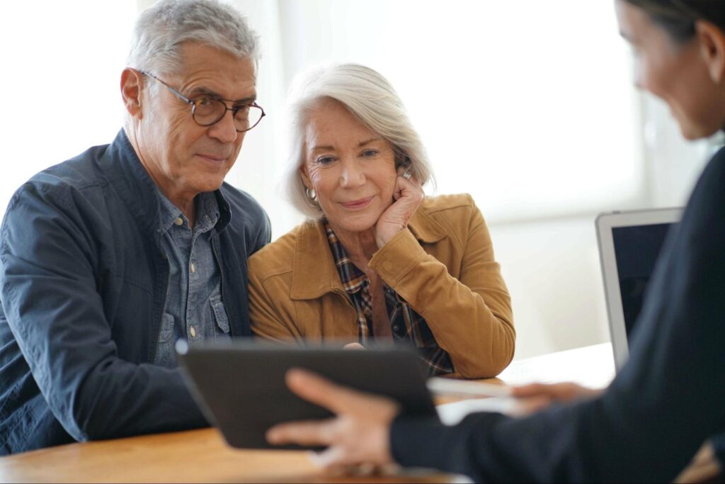 how to trade options: old man and woman looking at the tablet