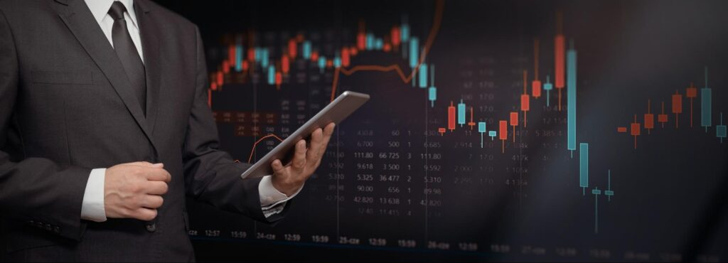 covered call strategy: Man holding a tablet with graph in the background