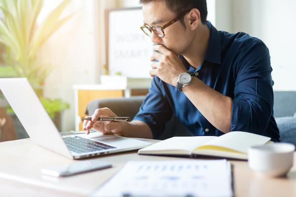 man checking rates on his laptop