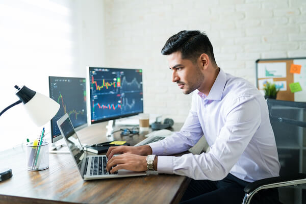 Options trader working on his laptop