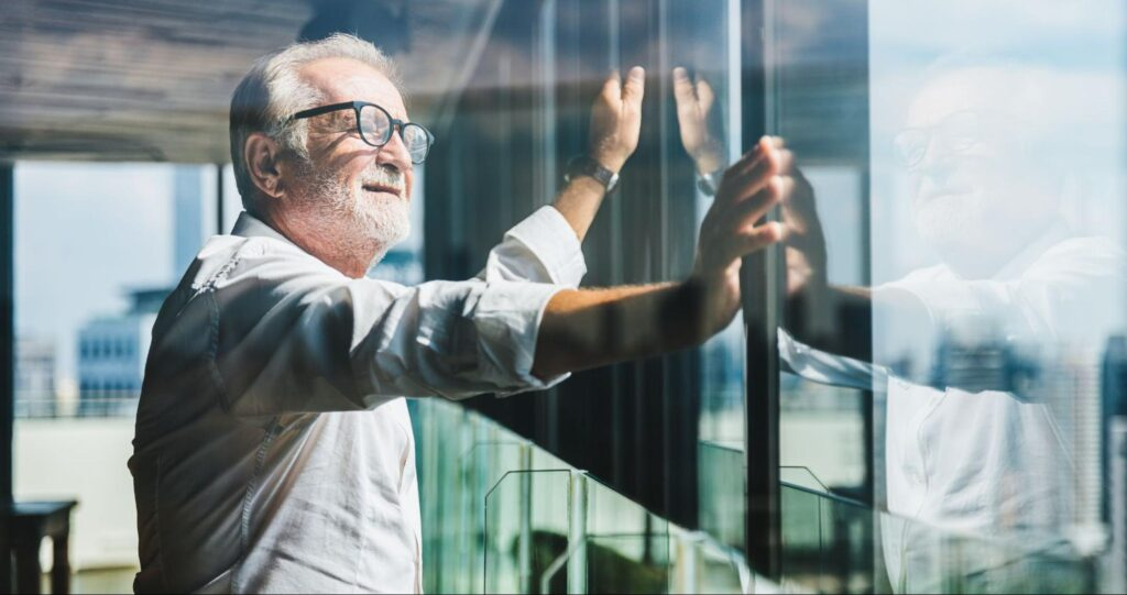 best stocks for retirement: old man staring out the window
