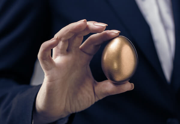 one stock retirement: person holding a golden egg