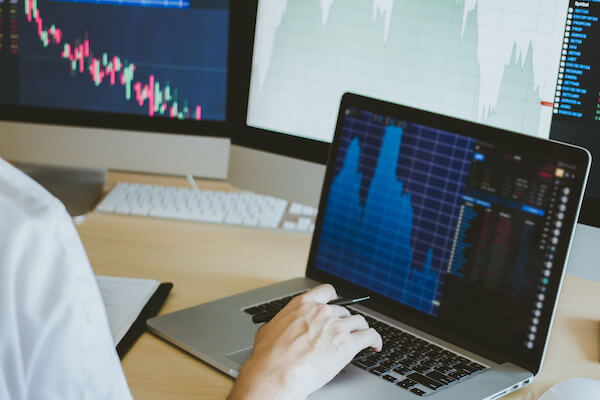 Dividend yield ratio: person working on charts and graphs
