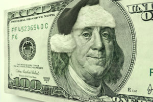 Ben Franklin is in the Christmas Spirit for the Holiday's wearing a Santa Hat and a smile, not normally seen on this Hundred Dollar Bill Portrait.