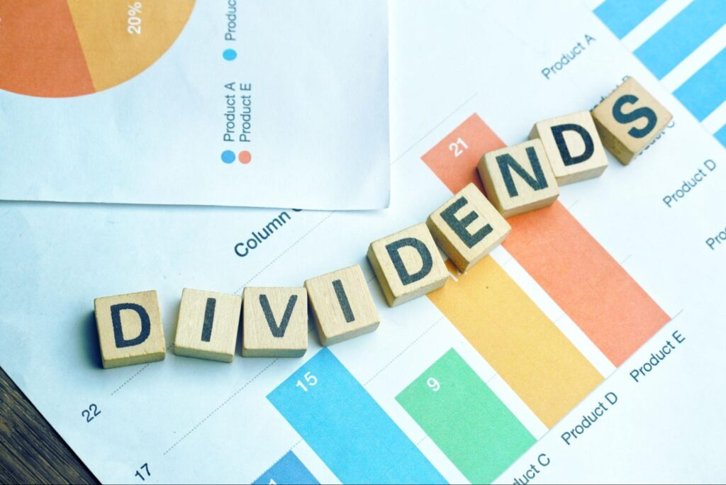 dividend stocks for retirement: small blocks used to spell out the word dividends