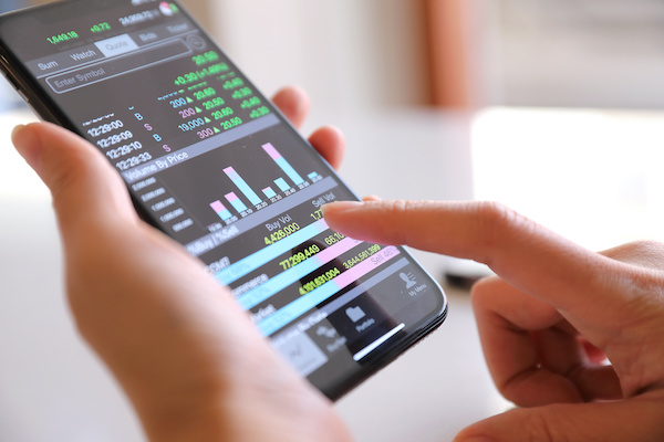 Covered call writing: trading stocks using a mobile phone