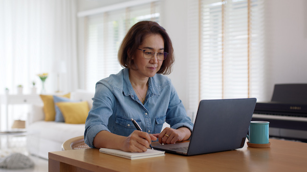 How to become an investor: woman working at home